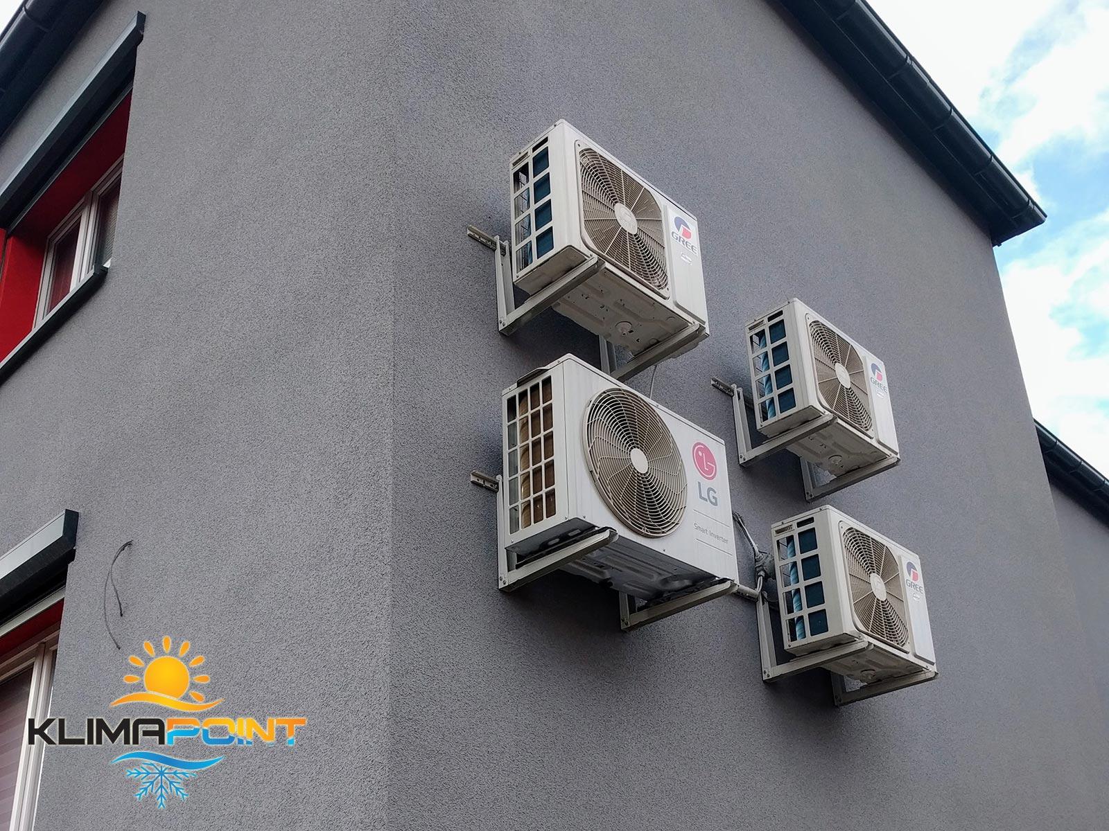 Jednostki zewnętrzne klimatyzatorów GREE i LG na elewacji